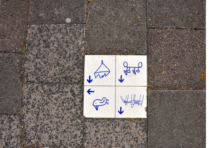 By FaceMePLS from The Hague, The Netherlands ('Stoeptegel' Draaiweg Utrecht) [CC BY 2.0 (https://creativecommons.org/licenses/by/2.0)], via Wikimedia Commons